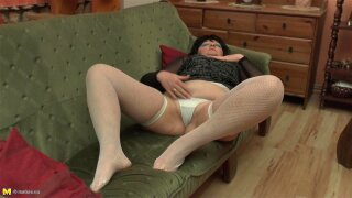 Granny in stockings loves fingering pussy on sofa mature shoot